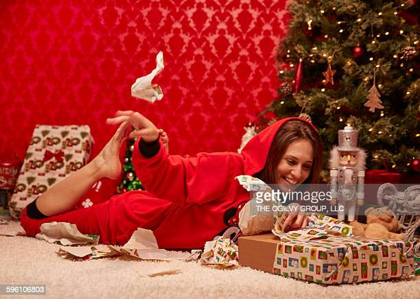 Woman rips wrapping off gift
