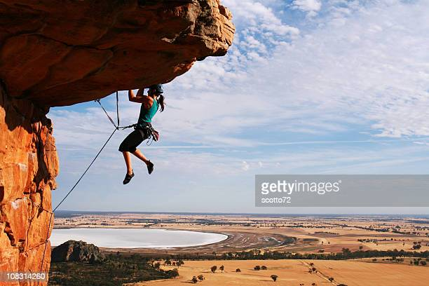 Woman rock climbing with ropes