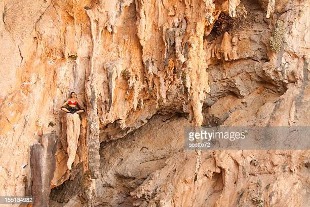 Woman rockclimbing meditating