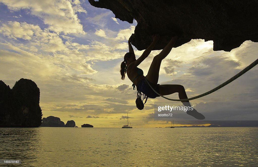 Woman rockclimbing silhouette : Stock Photo