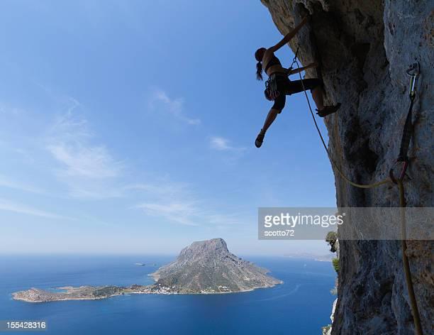 Woman rockclimbing silhouette