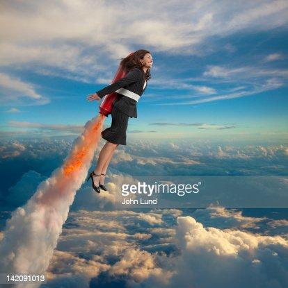 Woman Rocketing To Success : Stock Photo