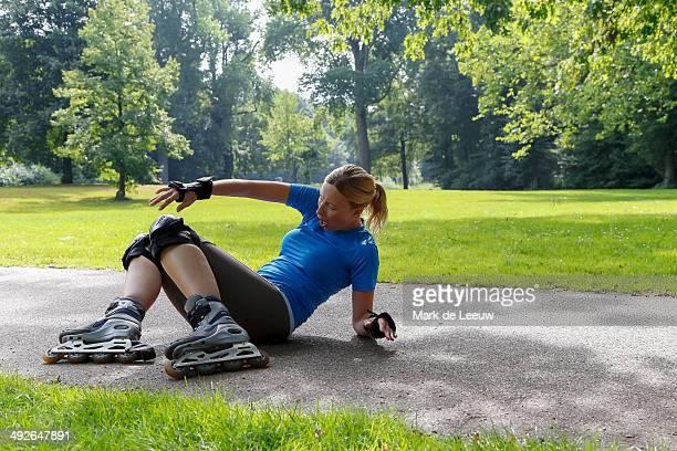Woman roller skating in park, Tilburg, Brabant, Netherlands