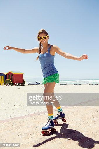 Woman roller skating on beach : Foto stock