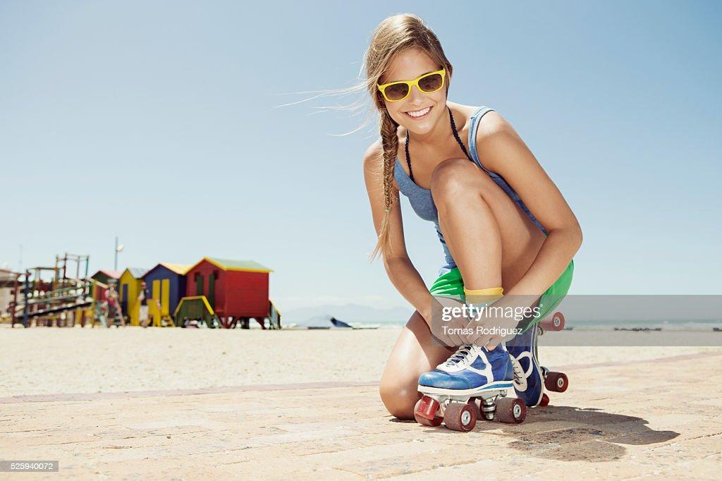 Woman roller skating on beach : Bildbanksbilder