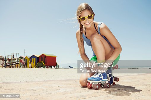 Woman roller skating on beach : Bildbanksbilder