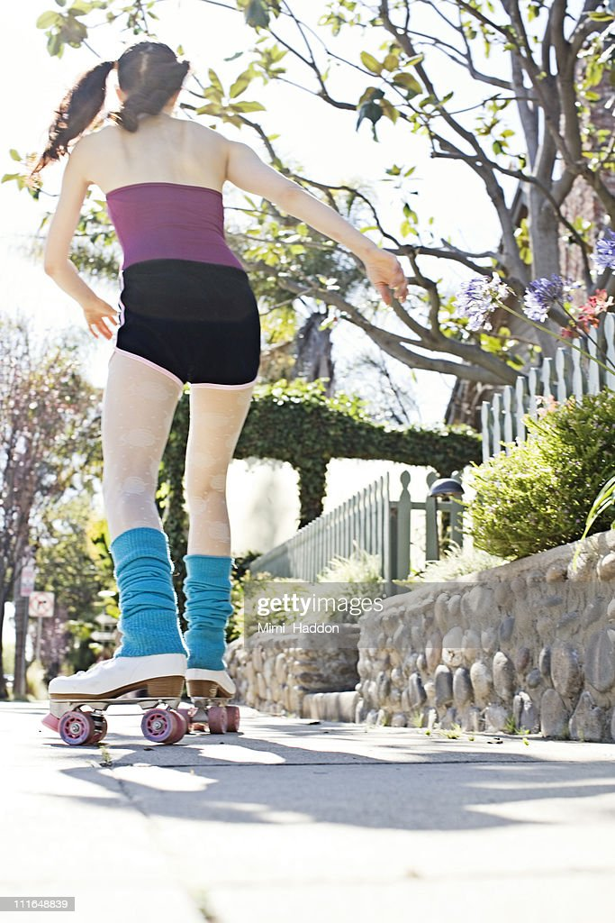 Woman Roller Skating on Sidewalk : Stock Photo