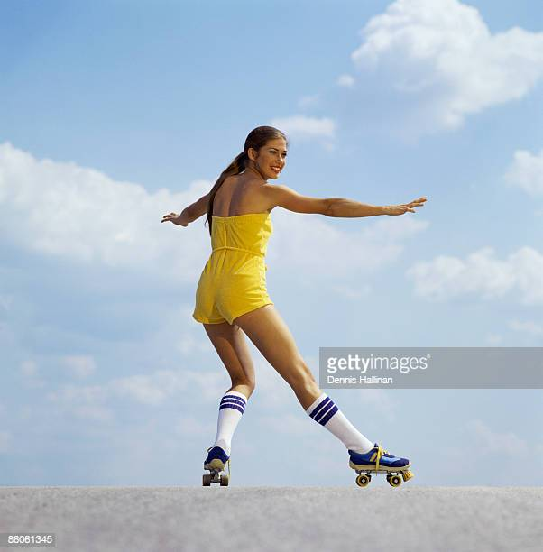 Woman roller-skating wearing jumpsuit