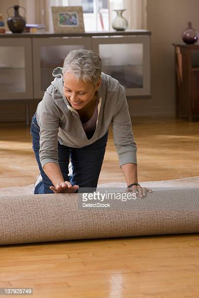 Woman rolling out carpet