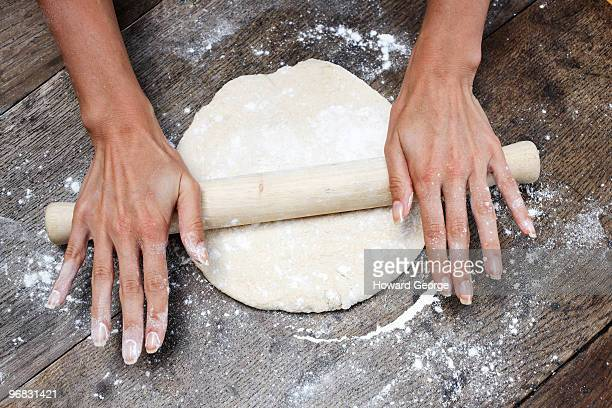 Woman rolling out fresh bread dough