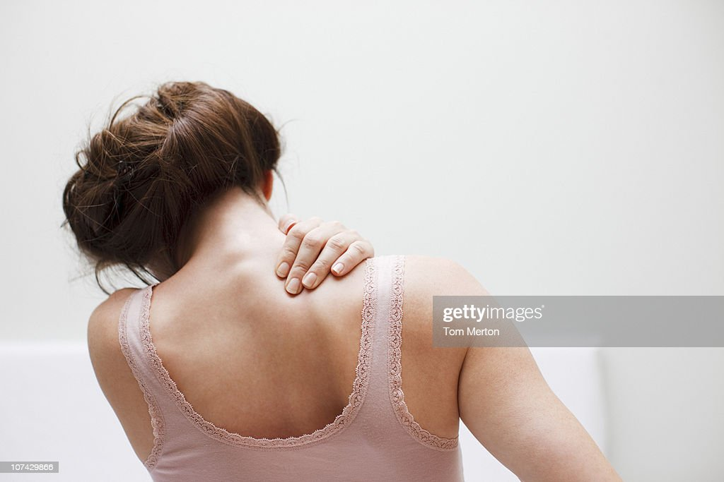 Woman rubbing aching back : Stock Photo