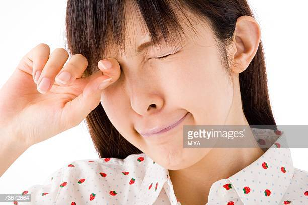 A woman rubbing her eyes