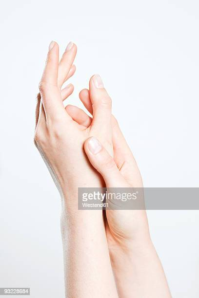 Woman rubbing her hands together, close-up