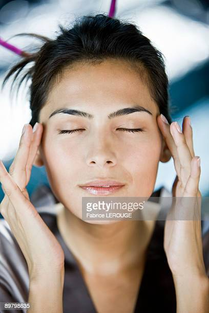 Woman rubbing her temples