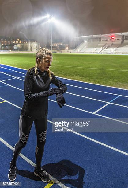 Woman runner checking her time
