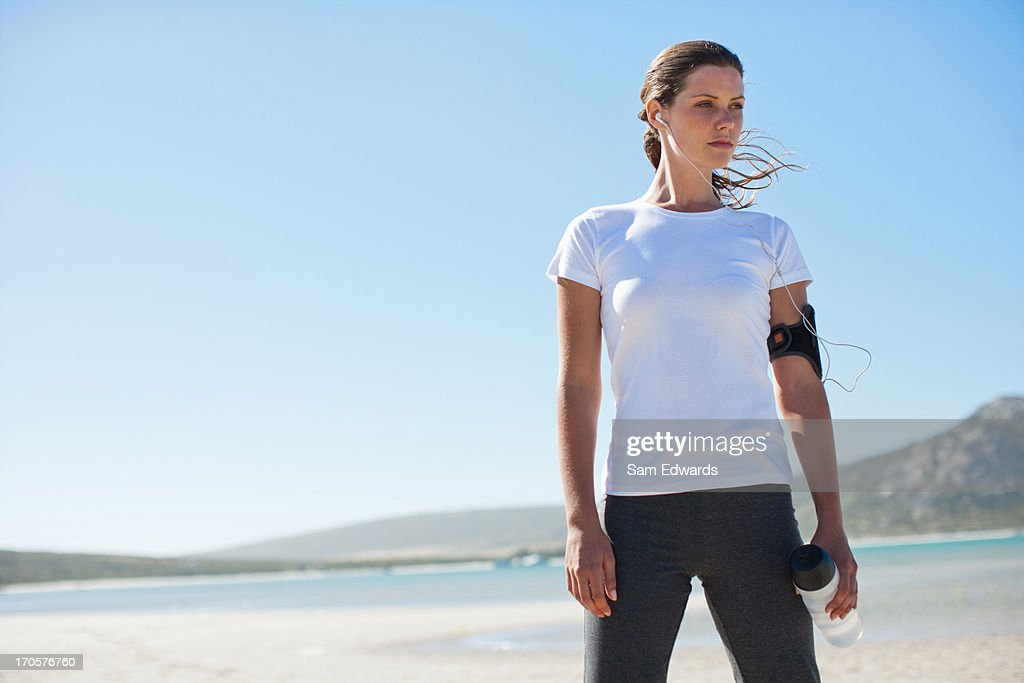 Woman runner relaxing and listening to mp3 player