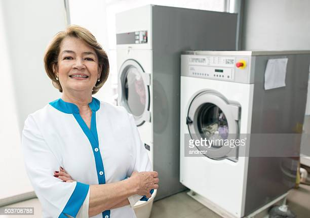 Woman running a laundry service shop