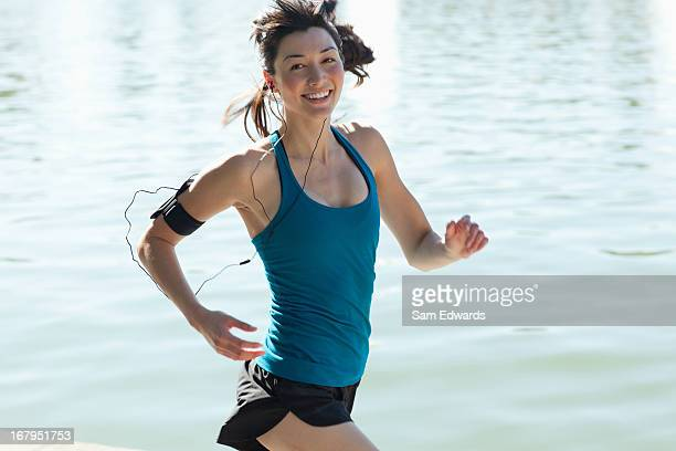Woman running along lake
