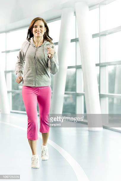 Woman Running at an Indoor Track