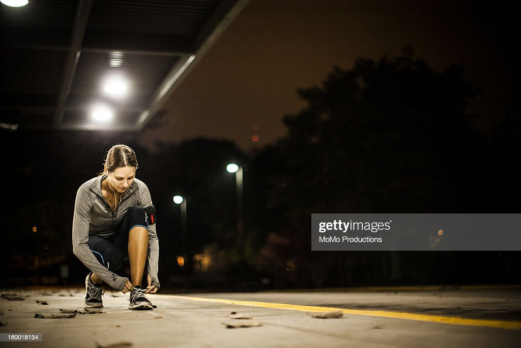 woman running at nighttime : Stock Photo