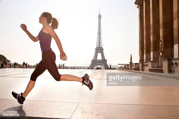 woman running at trocadero area of Paris