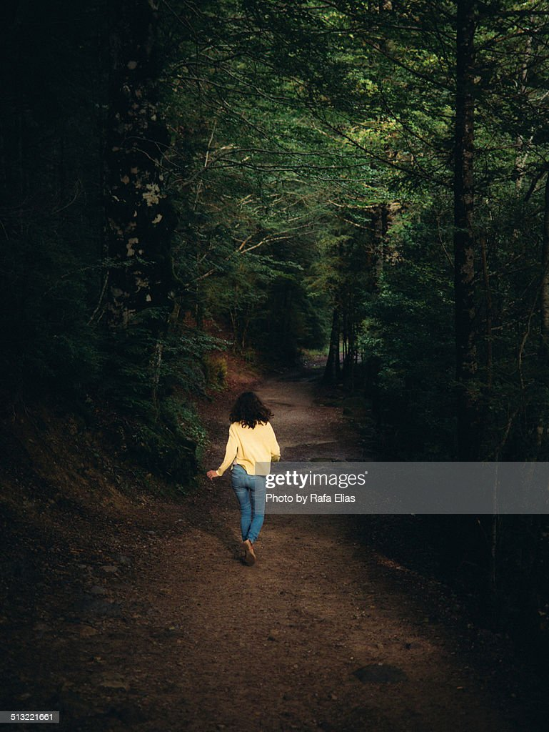 Woman running away in forest