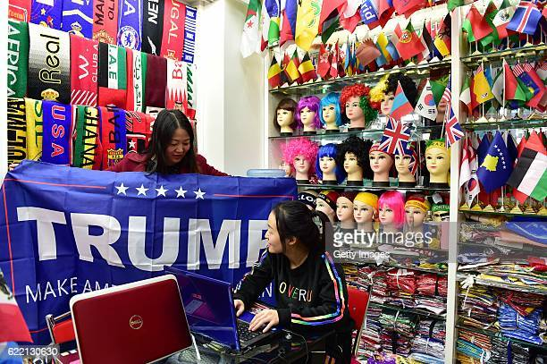 A woman running business of banners poses with a support banner for Republican presidential candidate Donald Trump at Yiwu International Trade Centre...
