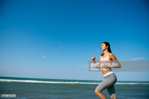 Woman running by the sea