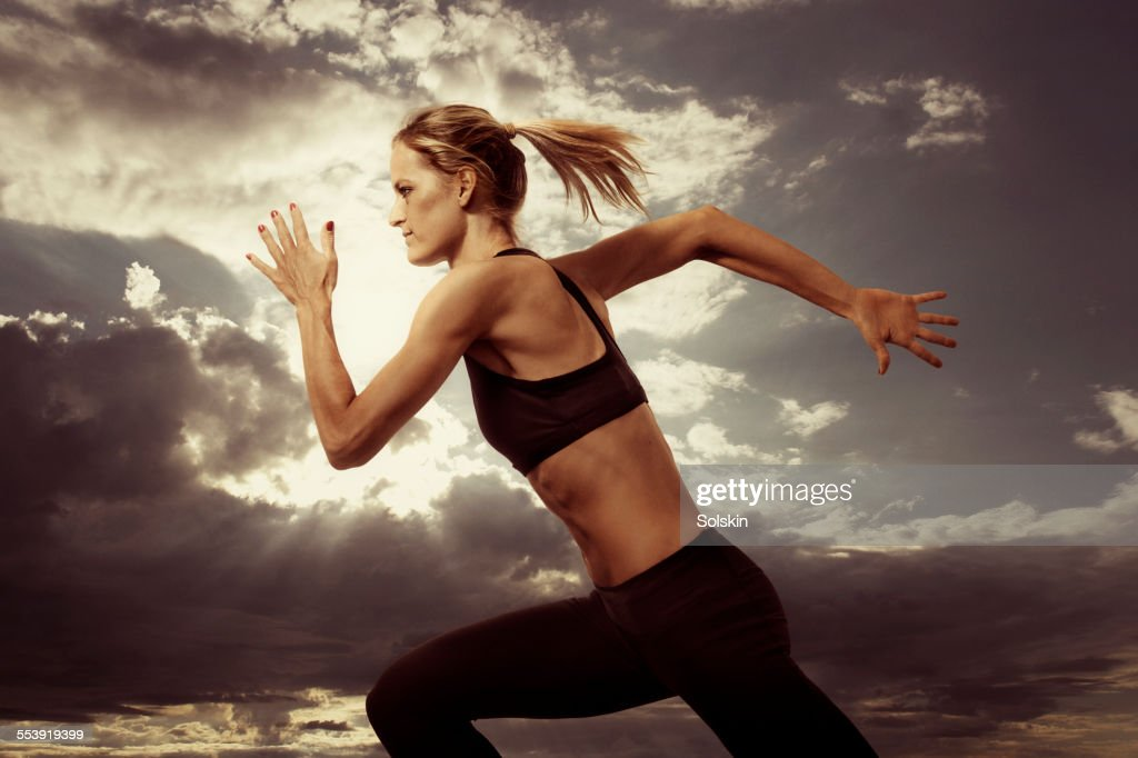 woman running. Evening sky in the background