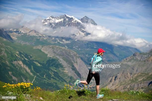 Woman Running in mountains at high altitude.