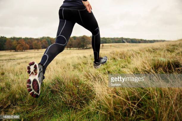 Woman running in nature with autumn colors