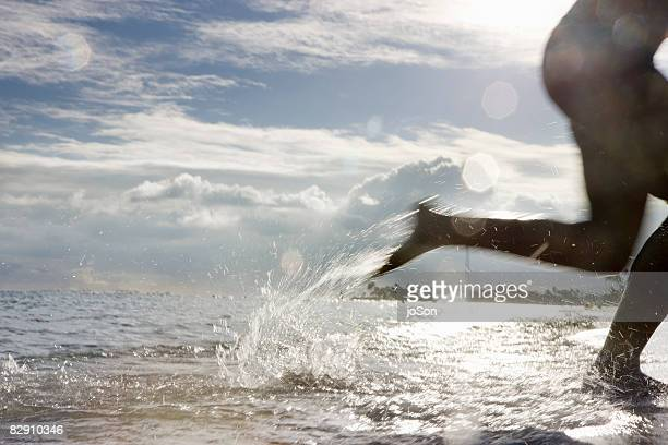 Woman running in Ocean
