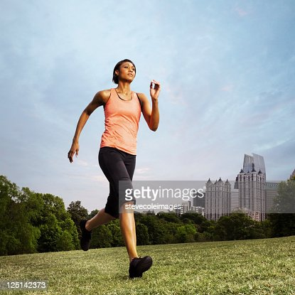 Woman Running in Piedmont Park on Grass Field : Stock Photo