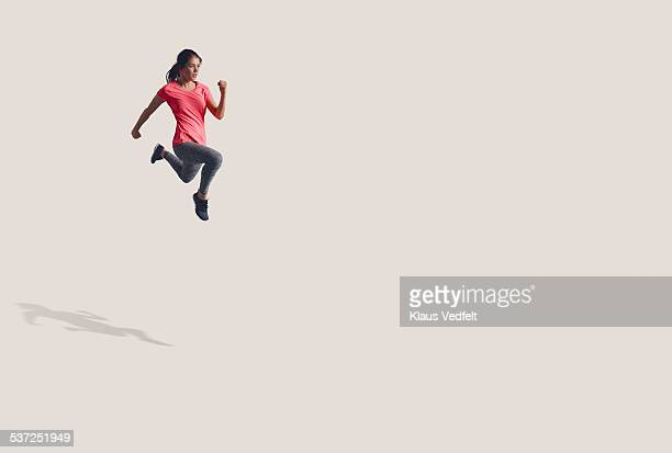 Woman running in the air in big space