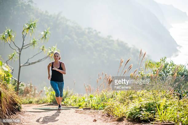 Woman Running in the Hawaiian Mountains