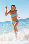 Woman running in the ocean
