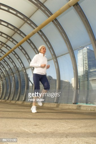 woman running in tunnel : Stock Photo