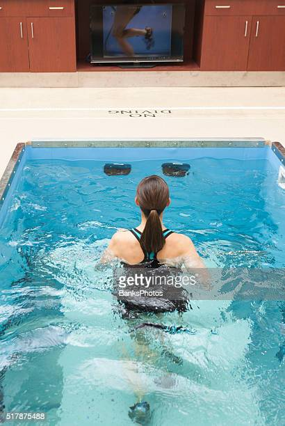Woman Running In Underwater Treadmill, Hydrotherapy Pool.