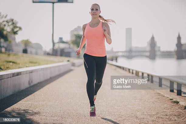 Woman running in urban scene.