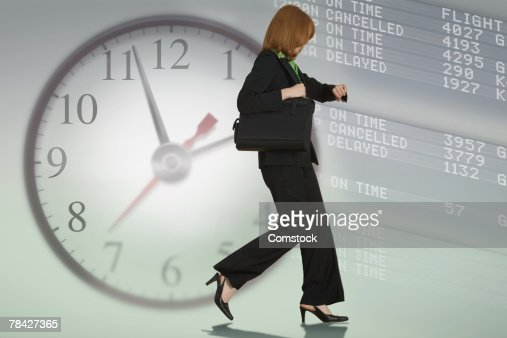 Woman running late for a flight : Stock Photo