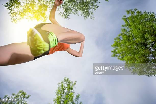 Woman running, mid-air