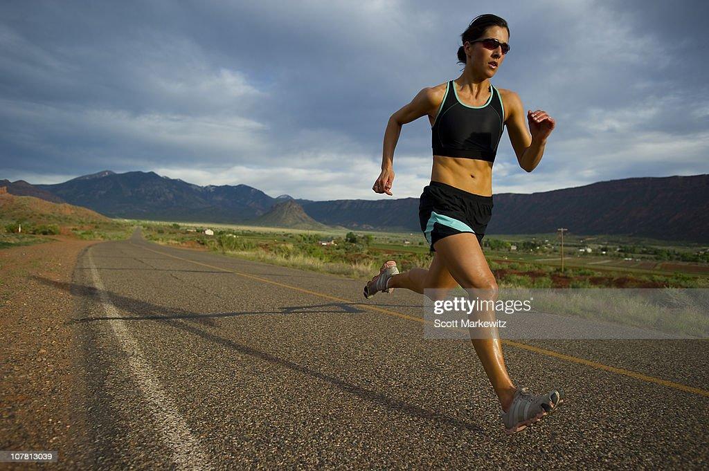 Woman running, Moab, Utah. : Stock Photo