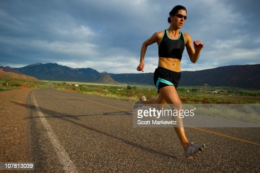 Woman running, Moab, Utah. : Stock Photo