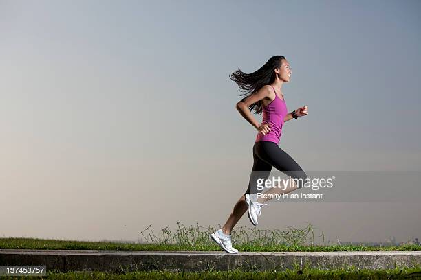 Woman running next to ocean