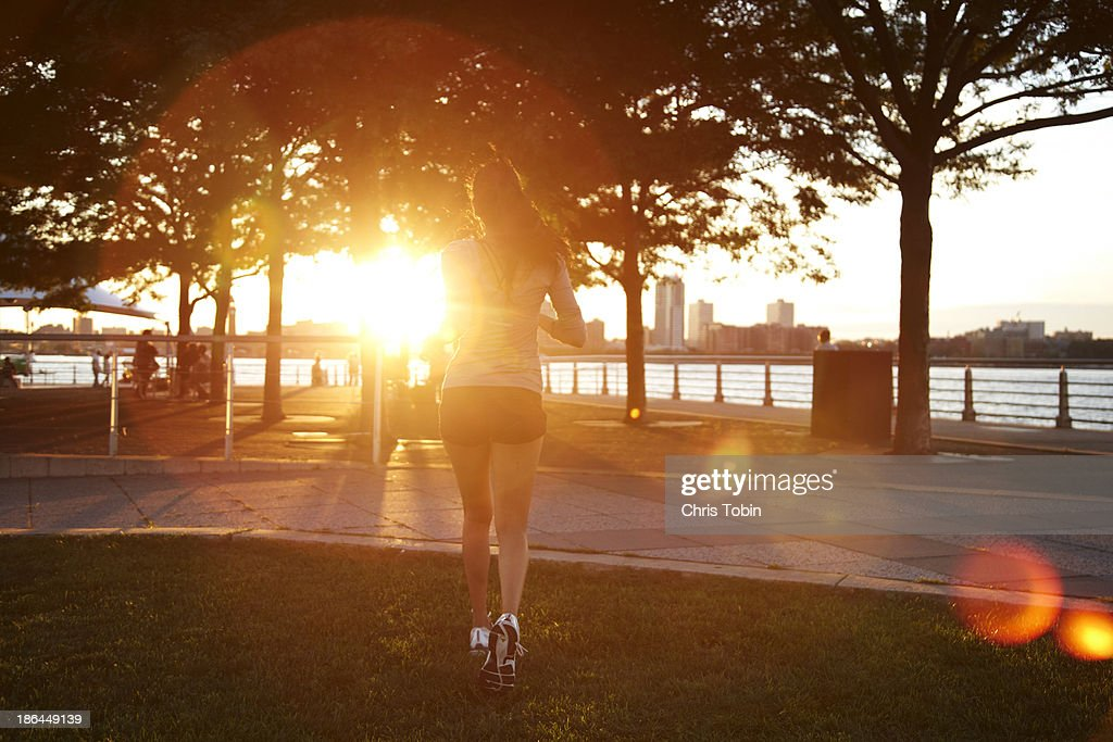 Woman running off into the sunset