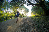 Woman running on a trail in California