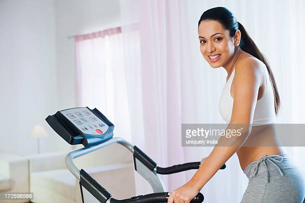 Woman running on a treadmill and smiling