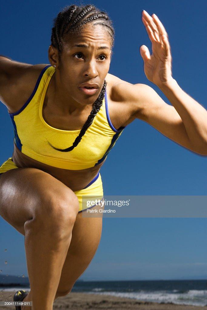 Woman running on beach, close-up : Stock Photo