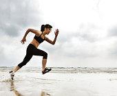 Woman running on beach