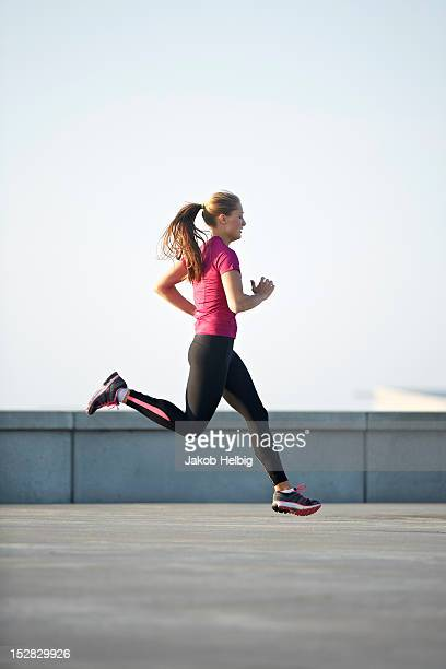 Woman running on rooftop